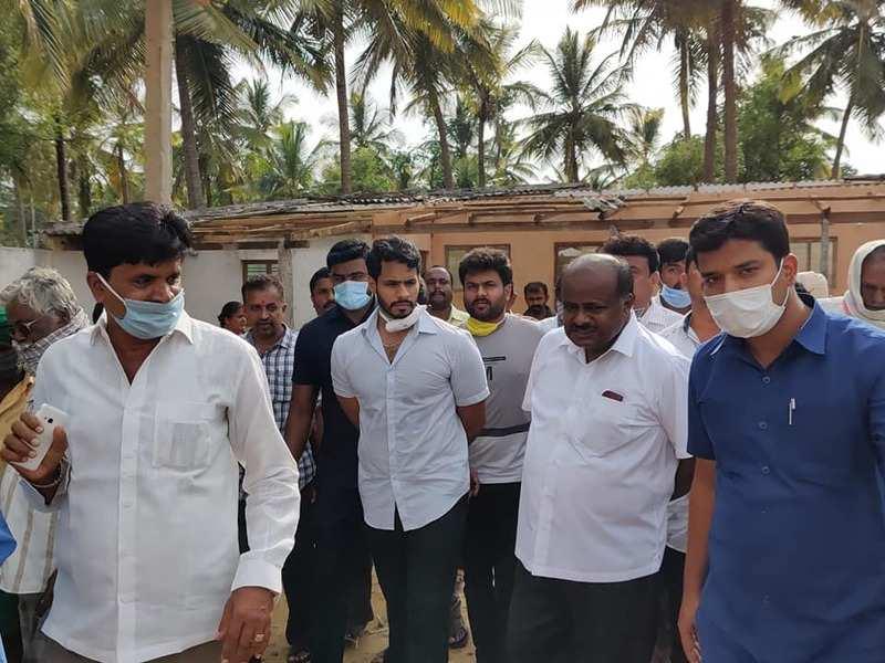 Nikhil Kumaraswamy joins father in assessing rain damage in Channapatna