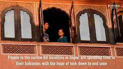 People in the curfew hit localities in Jaipur spend time in their balcony with the hope of lock down to end soon