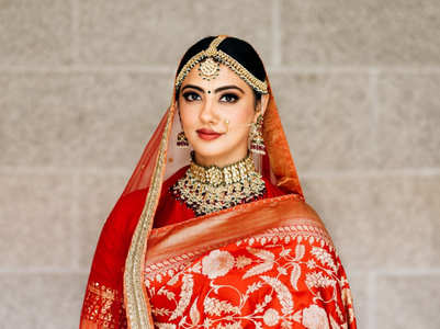 Sabyasachi bride in a beautiful red sari