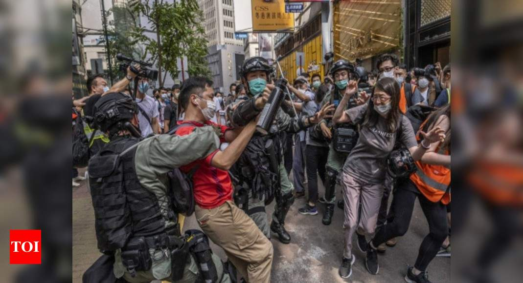 After China's security law, Hong Kongers hit panic button; Big spike in immigration inquiries – Times of India