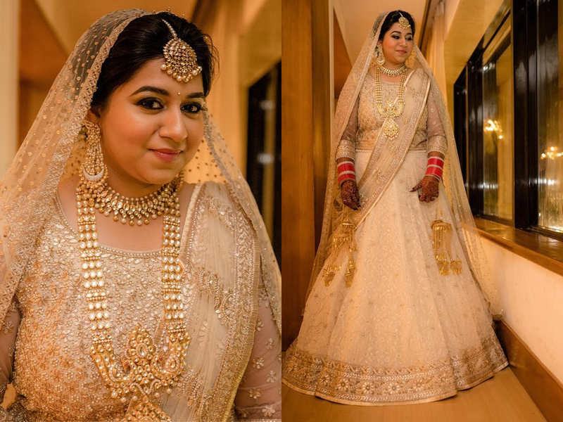 This bride wore a white and gold kalidar chikan lehenga and it's beyond beautiful