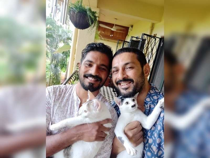 Apurva Asrani (right) and Sid with their cats Koko and Butter