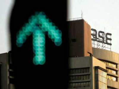 Sensex up 350 points, Nifty tops 10,200; Banks, realty stocks rally