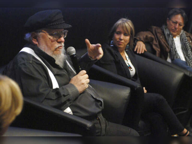 """FILE - In this Oct. 19, 2017, file photo, author and film producer, George R. R. Martin, left, speaks in Santa Fe, N.M. Martin, the famed author of the """"Game of Thrones"""" fantasy series, has joined a group to buy the historic Santa Fe Southern Railroad, the Santa Fe New Mexican reported Sunday, May 24, 2020.Photo/Morgan Lee, File)"""