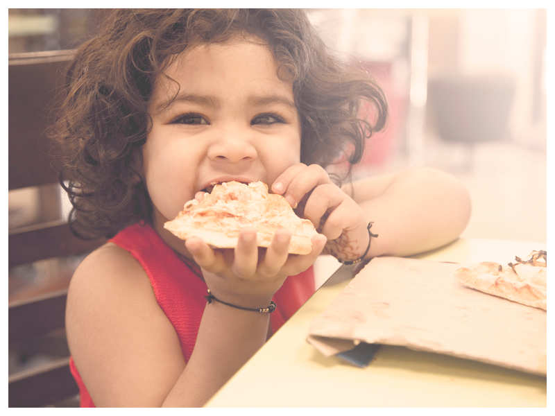 Representative Image: Child eating pizza