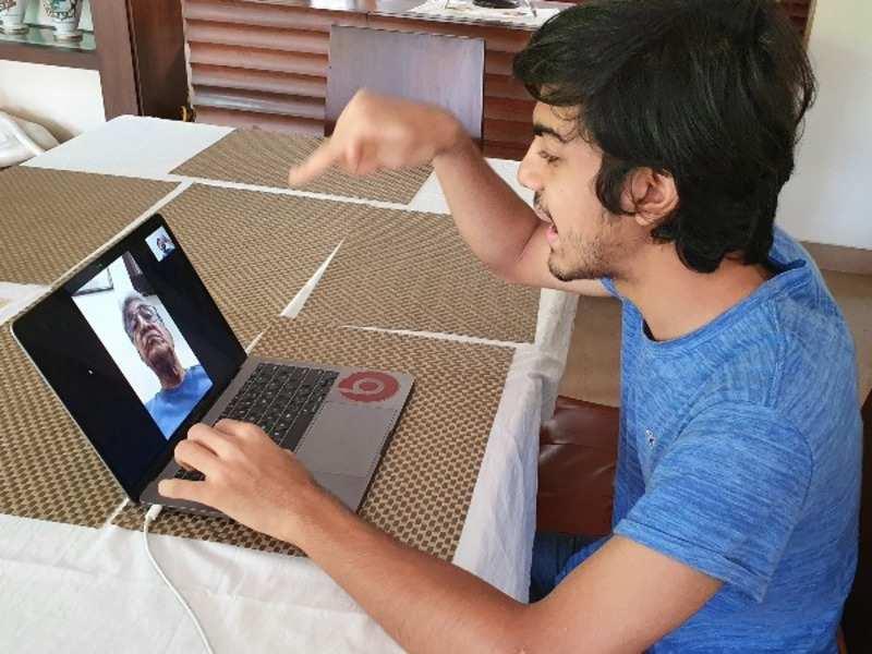 Manan Jain on a video call with a senior citizen