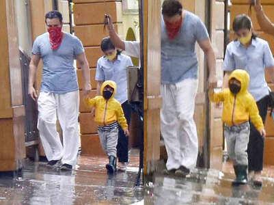 Pics: Taimur-Saif enjoy a walk in the rain