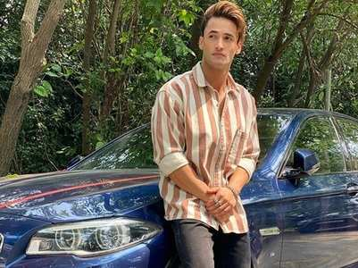 Asim Riaz poses with his luxury car; pics