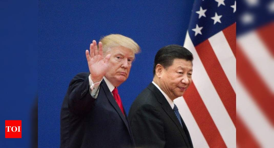 US sanctions Chinese officials over repression of minorities in Xinjiang; Beijing vows to retaliate – Times of India