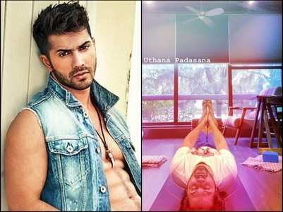 Varun aces the 'uttana padasana' yoga pose