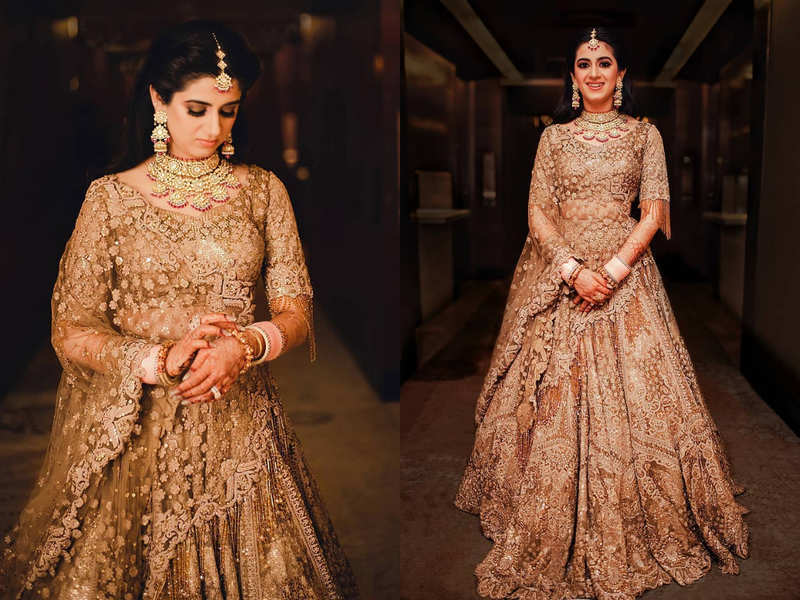 This bride wore a burnished gold lehenga for her wedding reception