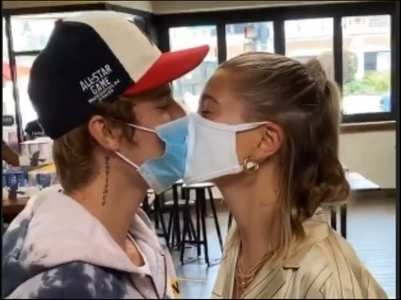 Video: Justin and Hailey share a mask kiss