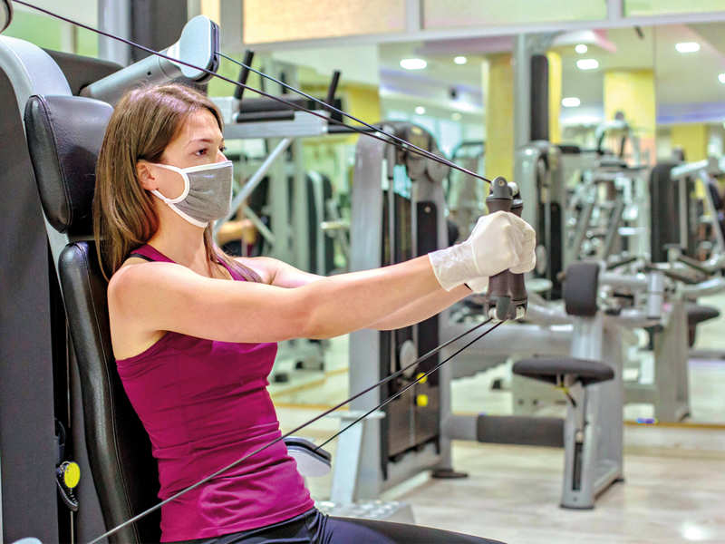 """TO MASK OR NOT TO MASK: A gym owner in the city says the gym won't have a say in whether a client has to wear a mask while exercising, adding, """"Some doctors point out it can be harmful, especially if they have breathing issues"""" (BCCL/ iStock)"""