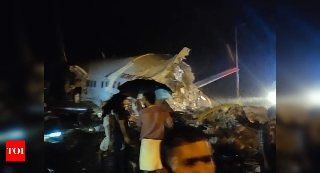 Plane crash in Kerala: Air India Express B737 overshoots Kozhikode airport on landing, falls into valley & breaks into two | India Business News – Times of India