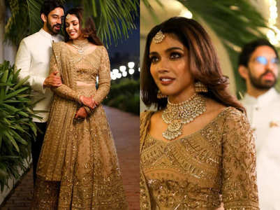 This bride wore a dull gold lehenga with corset for her wedding reception