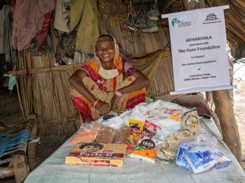 A lady smiles for the camera after receiving ration for the day
