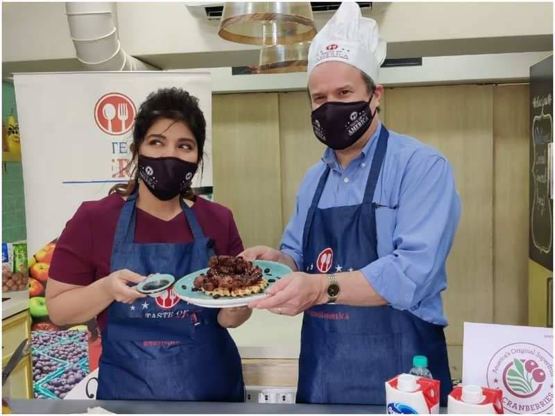 Rakhee Vaswani and  David J Ranz have fun in the cooking studio