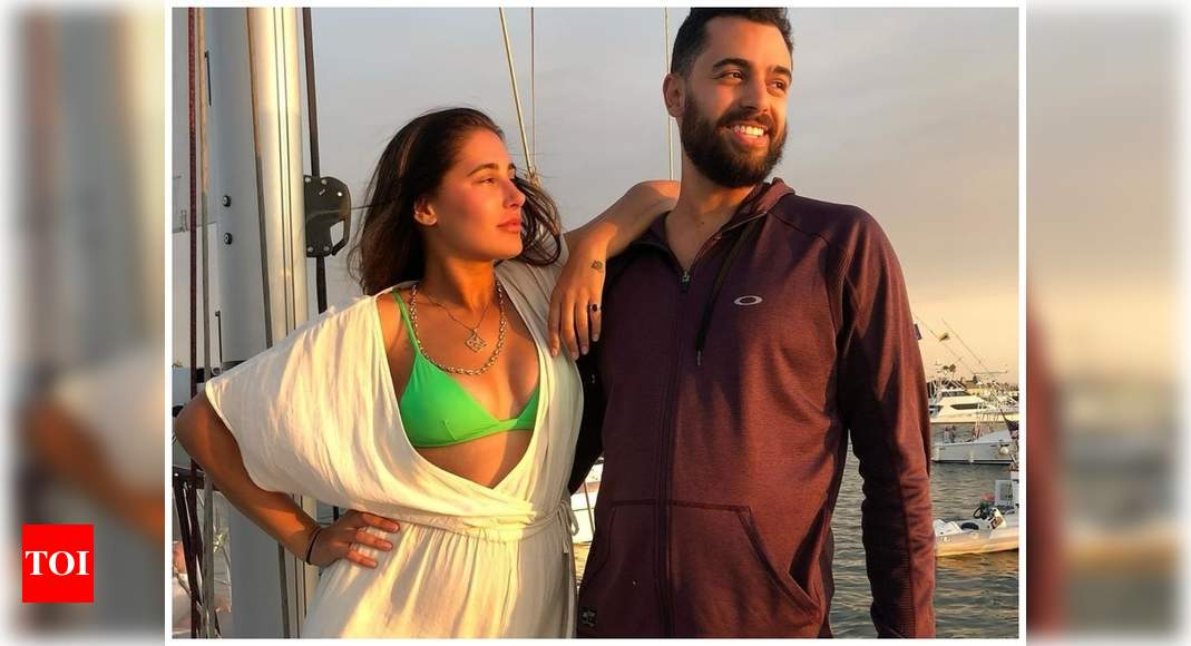 Nargis Fakri's beau Justin Santos shares a romantic post for the actress on social media: How did I get s - Times of India