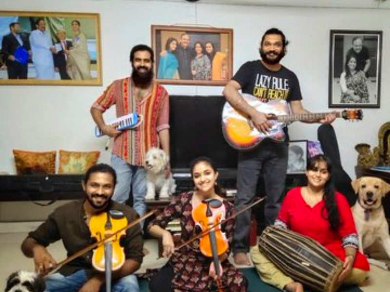 Keerthy Suresh poses with her family band