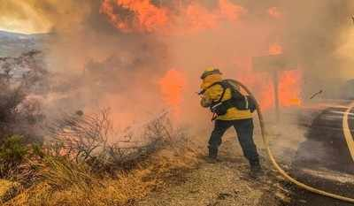 Death toll in West Coast wildfires reaches 35, officials anxious  about winds