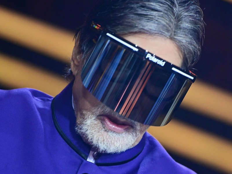 KBC12: Amitabh Bachchan covers his face with a shield