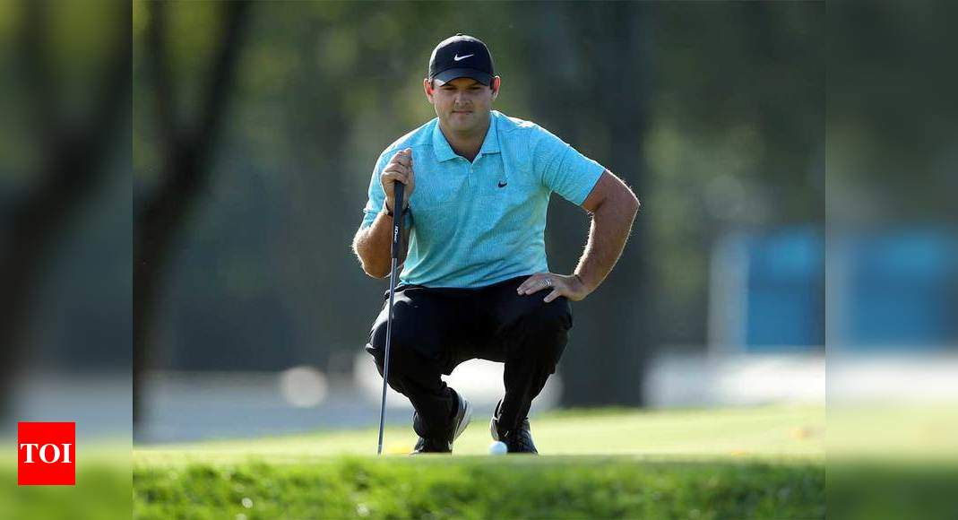 Reed grabs US Open halfway lead, Woods misses cut