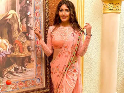 Surbhi looks stunning in a peach saree
