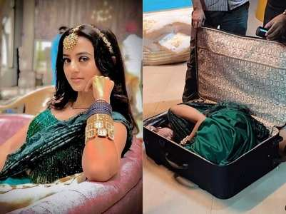 Helly shows how she fit into 'suitcase'
