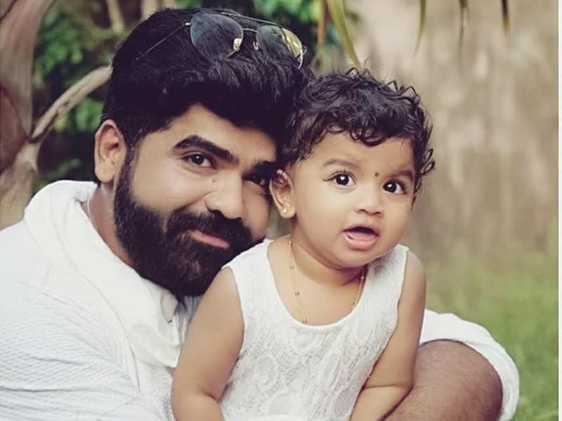 Deepan Murali's daughter Medhasvi enjoys a candid moment with pet dog Lux; watch video