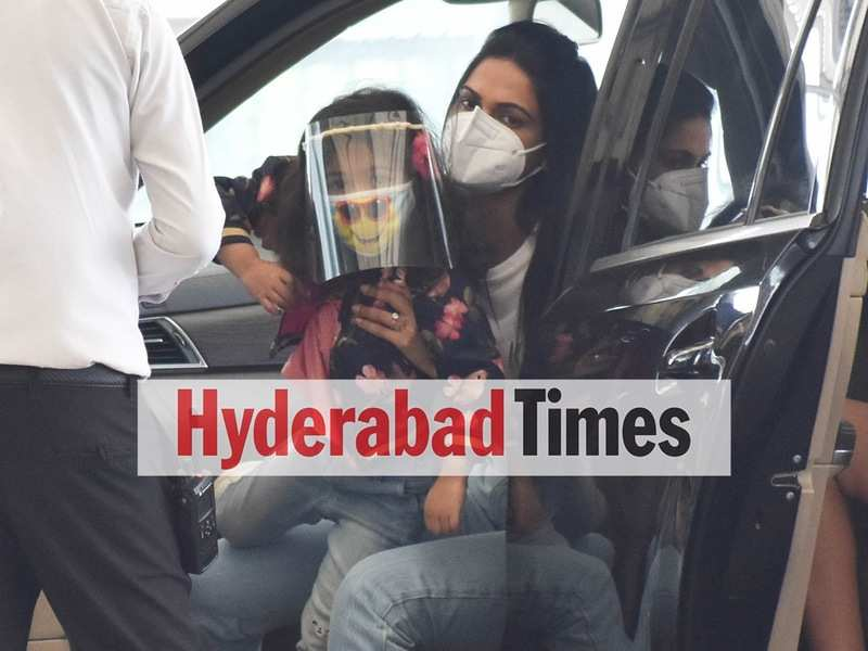 Sneha Reddy and Allu Arha in mask and face shields at the Hyderabad airport