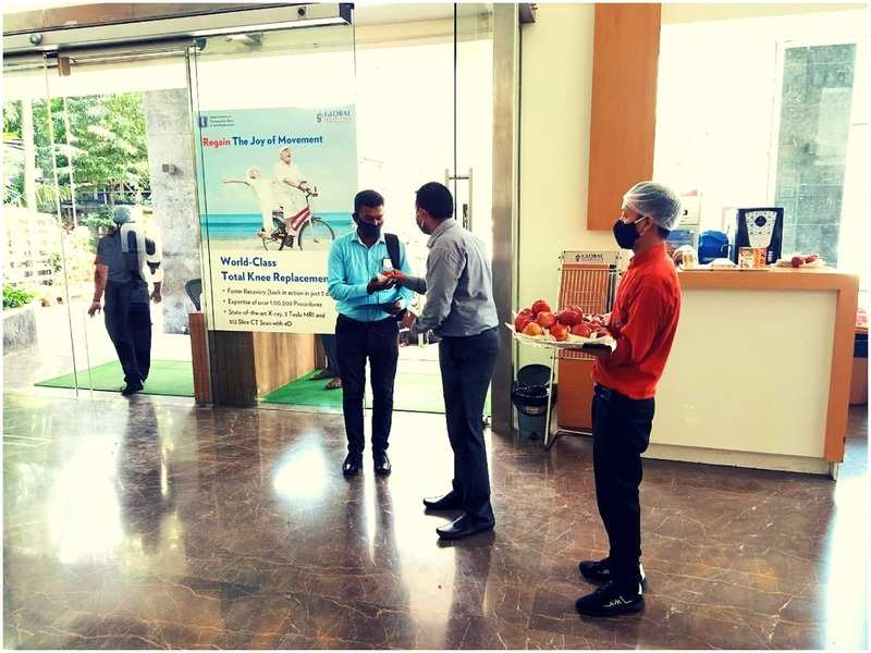 Distributing apples at Global  Hospital for World Heart Day