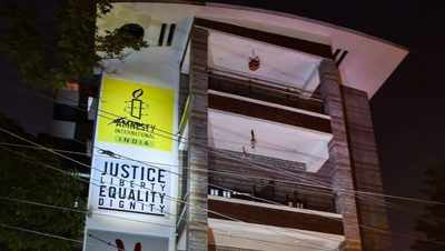 Human rights group Amnesty halts India operations, says faces harassment