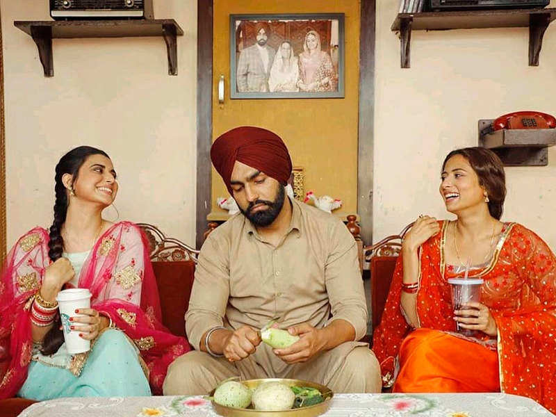 THESE pictures of Ammy Virk stuck between Sargun Mehta and Nimrat Khaira are sure to leave you in splits
