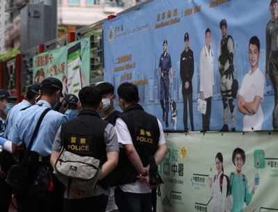 Hong Kong police patrol against protests on China holiday""