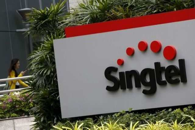 Singtel shares jump as company picks insider as CEO to tackle sector slump