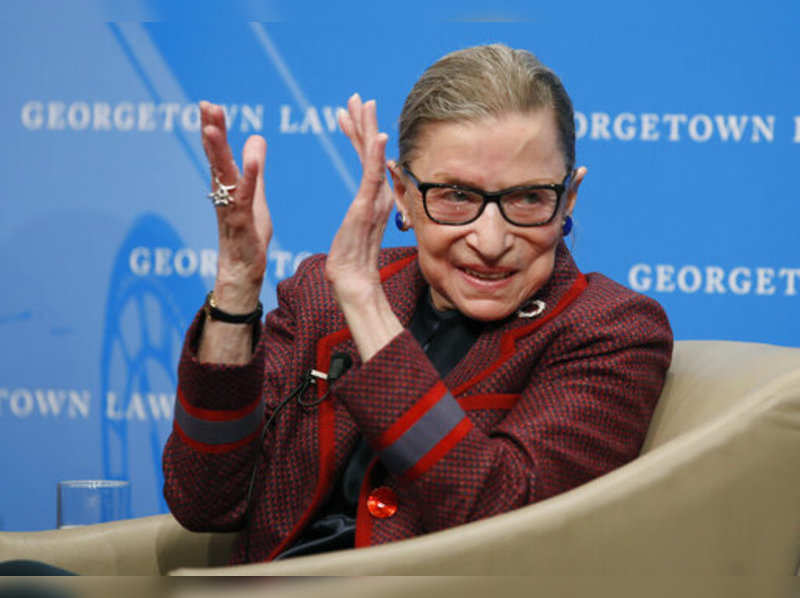 FILE - In this April 6, 2018, file photo, Supreme Court Justice Ruth Bader Ginsburg applauds after a performance in her honor after she spoke about her life and work during a discussion at Georgetown Law School in Washington. The Supreme Court says Ginsburg has died of metastatic pancreatic cancer at age 87.Photo/Alex Brandon, File)