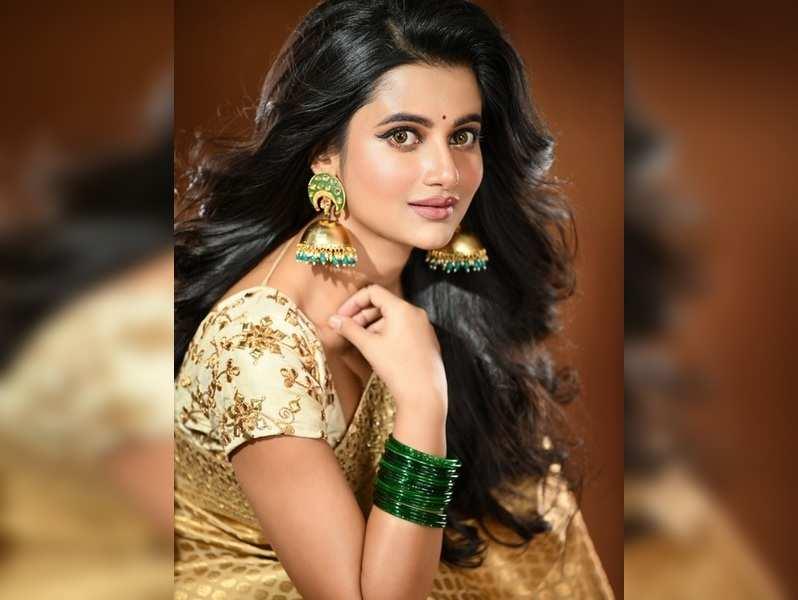 Ushasi loves to wear saris during Durga Puja