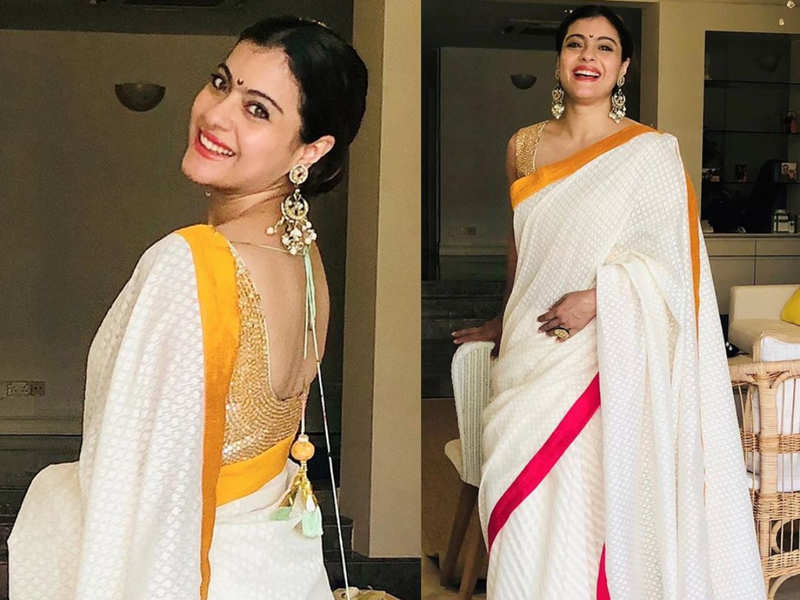 Kajol's white sari with yellow and pink border is our festive pick for the week