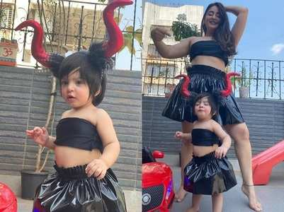 Mahhi twins in black with Tara for Halloween