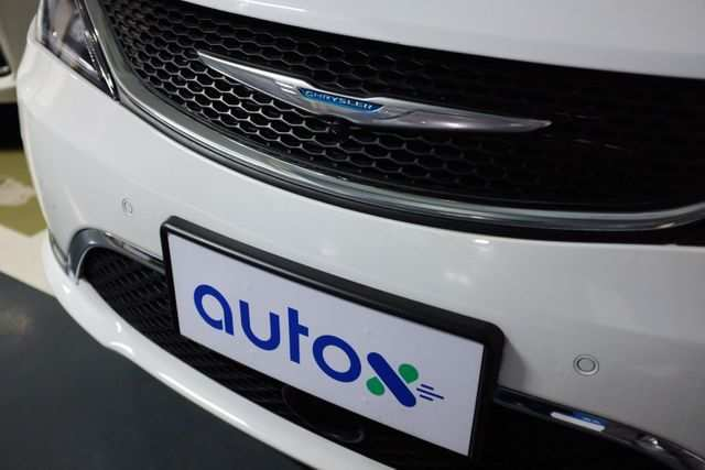 A sign of Alibaba-backed autonomous driving startup AutoX is seen on a modified Chrysler Pacifica minivan in Shenzhen, Guangdong province, China October 31, 2020. Picture taken October 31, 2020. REUTERS/Yilei Sun