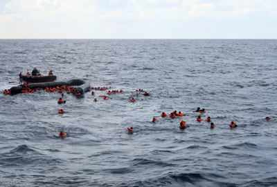 At least 74 migrants dead in shipwreck off Libya coast, IOM says - Times of India