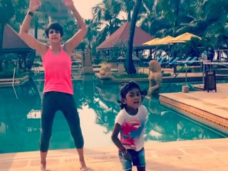 Mandira Bedi's daughter Tara gets inspired by her; does jumping jacks by the pool with her, watch