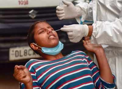 After 4 days, a slight dip in number of daily Covid cases | India News - Times of India