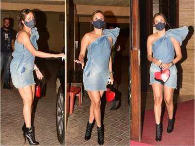 Malaika stuns in a one-shoulder denim outfit