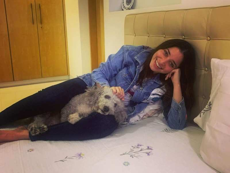 Tamannaah Bhatia cuddles with her furry baby Pebbles after a surprise visit home