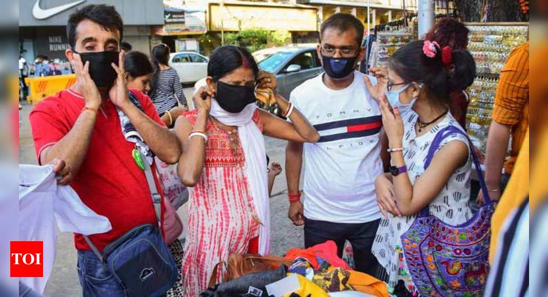 Covid-19 pandemic could be stopped if at least 70% public wore face masks consistently: Study – Times of India