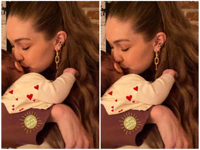 Gigi Hadid plants a kiss on baby ZiGi