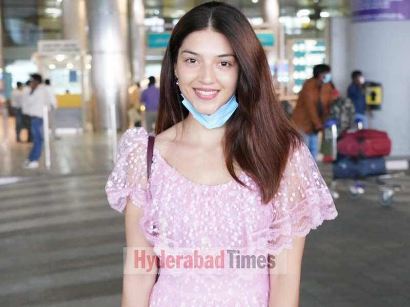 Spotted: Mehreen Pirzada all smiles in a whimsical pink dress at Hyderabad airport