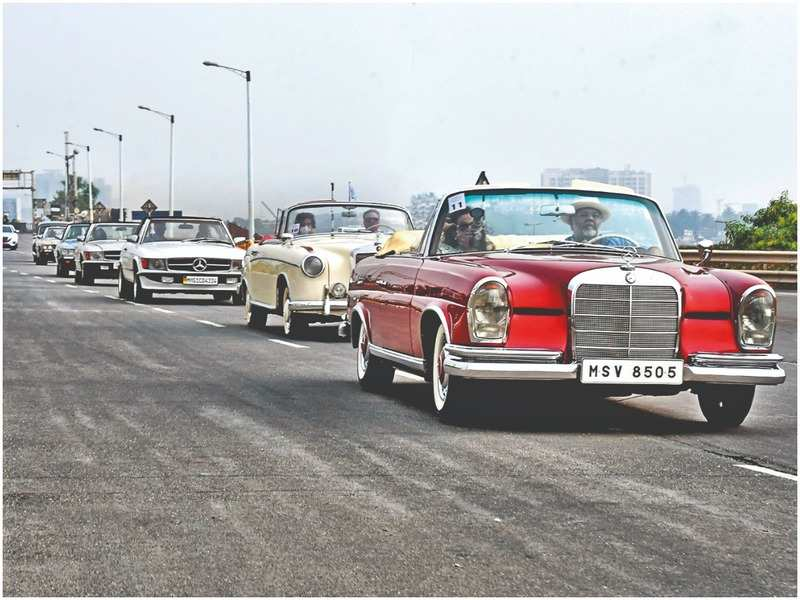 The convoy of classic cars makes their way through Worli during the rally