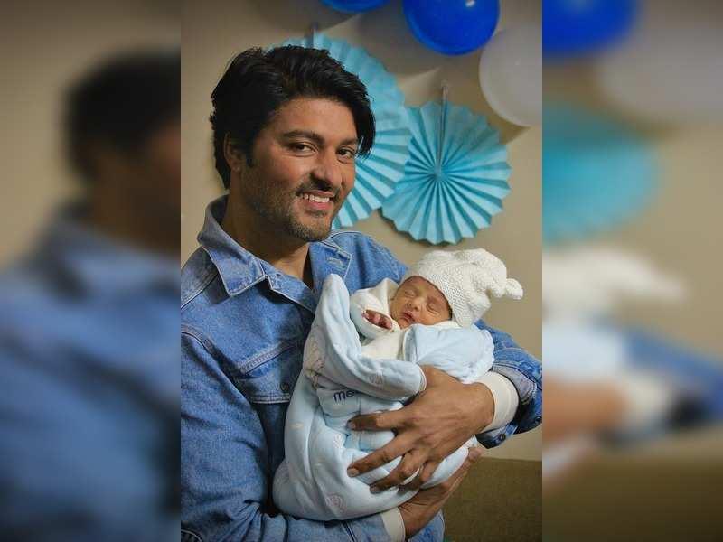 Anas Rashid with his newborn baby boy Khabib